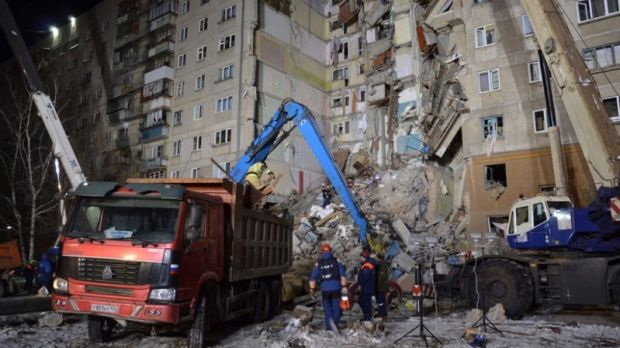 A handout photo from the Russian Emergency Situations Ministry Chelyabinsk Region shows rescue workers removing debris after a gas explosion in an apartment building in the city of Magnitogorsk. Photograph: EPA