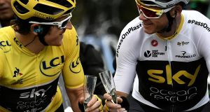 Geraint Thomas wearing the overall leader's yellow jersey and Chris Froome drink Champagne. Photograph: Marco Bertorello/Pool via Reuters/File Photo