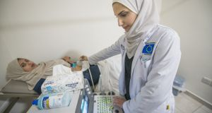 A doctor carries out a scan at the International Medical Corps maternity hospital in Irbid. Photograph: Peter Biro/European Union 2018
