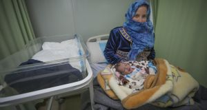 Maran from Daraa in southern Syrian holds her newborn daughter Matin at the maternity hospital in the Zaatari refugee camp. Photograph: Peter Biro/European Union 2018