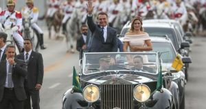 "Jair Bolsonaro, Brazil's new president, and his wife Michelle: ""We have a unique opportunity before us to reconstruct our country and rescue the hope of our compatriots."" Photograph: Andre Coelho/Bloomberg"