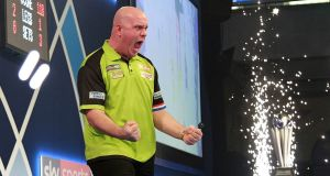 Michael van Gerwen celebrates after winning the PDC World Championship against Michael Smith at the Alexandra Palace. Photo: Sean Dempsey/EPA
