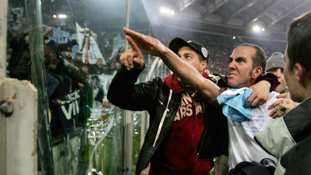 Paolo Di Canio raises a right arm salute to Lazio fans after a game against Roma in 2005. Photo: Paolo Cocco/Getty Images