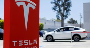 Shares in Tesla plunged after mildly disappointing Model 3 deliveries and an across-the-lineup price cut. Photograph: Mike Blake/Reuters