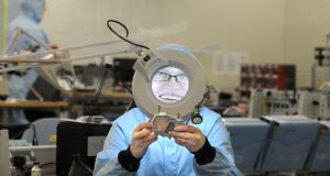 A worker at the Andor Technology factory. Photograph: Charles McQuillan/Pacemaker