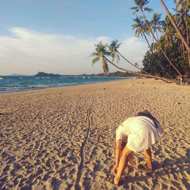 Fiona Hyde beachcombing on Ngapali Beach in Myanmar
