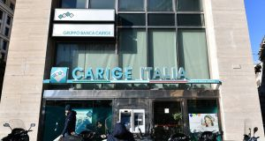 A branch of Italian bank Carige Italia in Rome. Photograph: Alberto Pizzoli/AFP/Getty Images