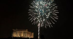 Fireworks explode above the ancient Parthenon temple atop the Acropolis hill during New Year celebrations. Photograph: Milos Bicanski/Getty Images