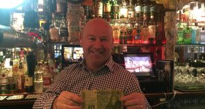 "Alan Campbell with an Irish punt in The Bankers Bar: ""People are happier to part with their money when they know exactly what things cost. It's much less hassle."""