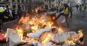 Gilets jaunes (yellow vests) protesters set fire to garbage bins and other items in Bordeaux. Photograph: Mehdi Fedouach/AFP/Getty Images