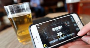 The amount of time people  spend on their smartphones in pubs and restaurants is damaging Ireland's hospitality culture, according to a Fine Gael Senator. File photograph: Chris Ratcliffe/Bloomberg