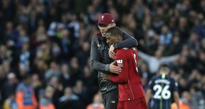 Liverpool manager Jurgen Klopp embraces Georginio Wijnaldum after another impressive display. Photograph: Rich Linley/Getty