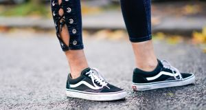 "Vans black and white sneakers shoes. The American company claim Primark have been selling 'knock-offs"" of their product. Photograph:  Edward Berthelot/Getty Images)"