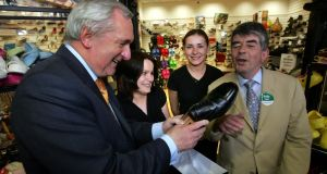 Peter Kelly (right) pictured with the then taoiseach Bertie Ahern testing a pair of shoes offered for the 2007 General Election campaign. Photograph: Matt Kavanagh/Irish Times