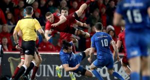 Leinster's James Lowe collides with Munster's Andrew Conway during the Guinness Pro 14 derby at Thomond Park. Photograph: Dan Sheridan/Inpho