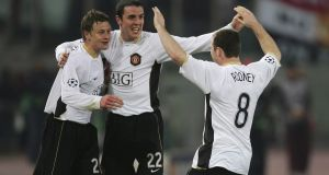 John O'Shea celebrates with Ole Gunnar Solskjær and Wayne Rooney  after scoring the equalising goal against Roma at the Stadio Olimpico during the Champions League quarter-final in April 2007. Photograph:   Alex Livesey/Getty Images