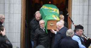 The remains of actor Jer O'Leary, being carried out of the Church of St. Agatha's. Photograph: Dara Mac Dónaill / The Irish Times