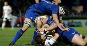 Leinster's Max Deegan and Andrew Porter tackle former Ireland U-20 teammate Ulster's Johnny McPhillips at the RDS last January.  Photograph: Tommy Dickson/Inpho