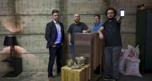 Chris McClelland, Jonny Campbell, Ali Sisk and Kieran Graham, the co-founders and creators of Brewbot, in the company's workshop in Portadown, Co Armagh. Photograph: Paulo Nunes dos Santos for The New York Times