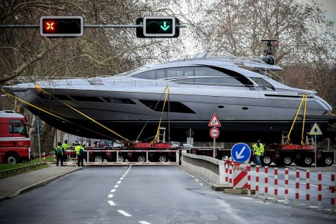 The Pershing 8X luxury yacht is transported across a street in Duesseldorf, Germany. The yacht is one of the first vessels delivered from the absolute shipyard for the 50th edition of the water sports fair, Boot. Photograph Sascha Steinback/EPA