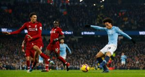 Manchester City's Leroy Sané scores their second goal during the Premier League match against Liverpool at the Etihad Stadium. Photograph: Phil Noble/Reuters