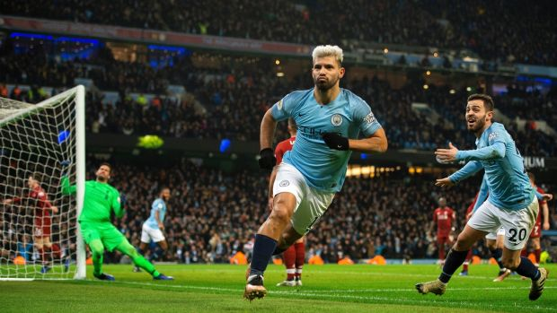 Manchester City's Sergio Agüero celebrates scoring the opening goal during the Premier League match against Liverpool at the Etihad Stadium. Photograph: Peter Powell/EPA