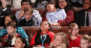 Michigan Democrat Rashida Tlaib  holds a sleeping child as the US House of Representatives meets for the start of the 116th Congress on Thursday. Photograph:  Jonathan Ernst/Reuters