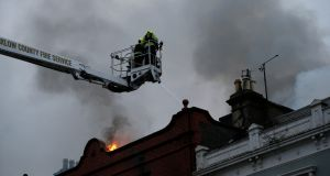 Firefighters from the Wicklow County Fire service at the scene. Photograph:  Nick Bradshaw/ The Irish Times