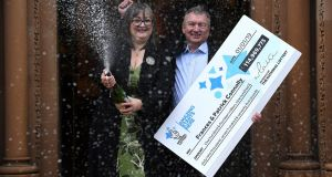 Frances (52) and Patrick Connolly (54) from celebrate winning the New Year's day EuroMillions Lottery jackpot. Photograph: Clodagh Kilcoyne/Reuters