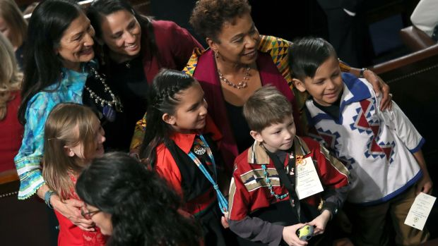 Children pose with member-elect reps Deb Haaland (L), Sharice Davids, Barbara Lee (R) during the first session of the 116th Congress. Photograph: Win McNamee/Getty Images