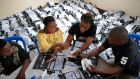 Congolese independent electoral commission officials count presidential ballots in Kinshasa. Photograph: Jerome Delay/AP Photo