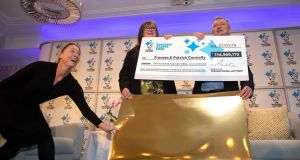 EuroMillions lottery winners Frances (centre) and Patrick  Connolly:  won the £114,969,775 million jackpot in the New Year's Day draw. Photograph: Paul Faith