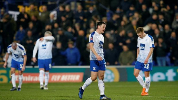 Tranmere Rovers' Connor Jennings and team mates look dejected. Photo: Andrew Yates/Reuters