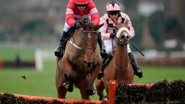 Ruby Walsh and Laurina lead Sensulano and Barry Geraghty at Sandown. Photograph: Alan Crowhurst/Getty