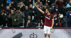 West Ham United's Andy Carroll celebrates scoring his side's second goal of the game during the FA Cup third round win over Birmingham City. Photo: Steven Paston/PA Wire