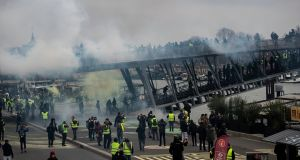 Protesters try to cross a bridge over the Seine river during a 'yellow vests' protest in Paris, France. Photograph: Ian Langsdon/EPA