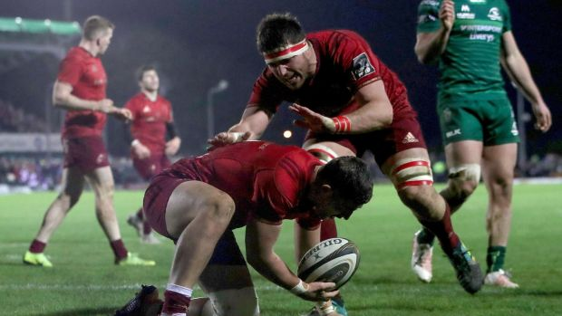 Dan Goggin crosses for Munster in the second half of their win in Galway. Photograph: Bryan Keane/Inpho
