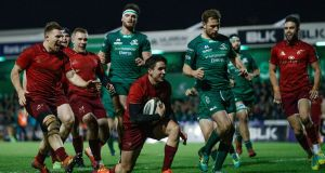 Joey Carbery scores Munster's crucial fourth try in their win over Connacht at The Sportsground. Photograph: James Crombie/Inpho