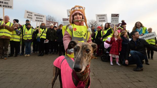 Ella Dooley with Lady, who joined the Fingal Dog Owners Group protest march. Photograph: Dara Mac Dónaill/The Irish Times