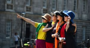 Tourists enjoy the weather and sites in Trinity College Dublin. File photograph: Dara Mac Dónaill/The Irish Times