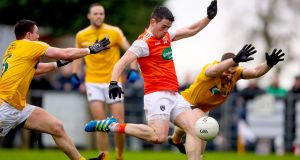 Armagh's Jack Grugan tries to get a shot away during his side's win over Antrim. Photograph: Tommy Dickson/Inpho