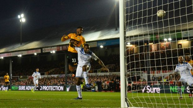 Jamille Matt leaps to score Newport County's opener against Leicester. Photograph:Dan Mullan/Getty