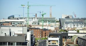 Construction cranes on the Dublin skyline. With building professionals in short supply, recruitment executives are on a global hunt for construction staff. File photograph: Aidan Crawley