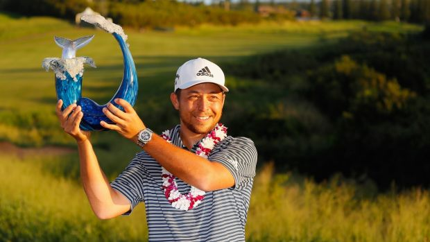 Schauffele poses with the trophy after winning. Photo: Kevin C. Cox/Getty Images