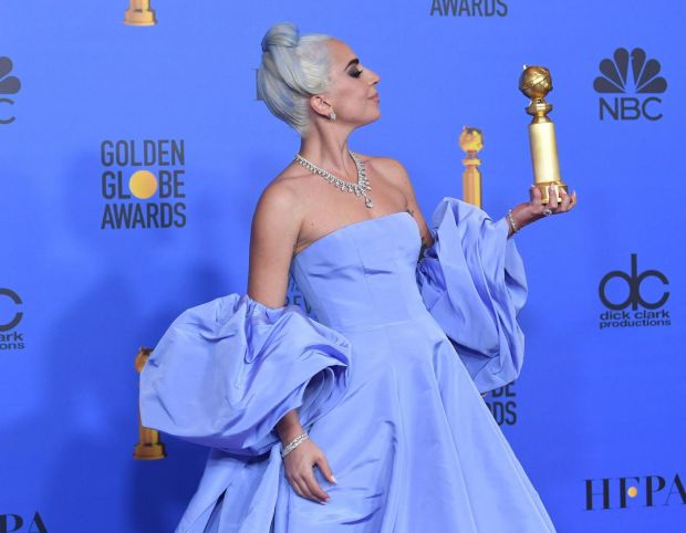 Lady Gaga stole the show with her blue hair and blue gown. Photograph: Kevin Winter/Getty Images