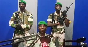 "A video grab of Gabonese soldiers on state radio calling on the people to ""rise up"" and announcing a ""national restoration council"" would be formed. Photograph: AFP/Getty Images"
