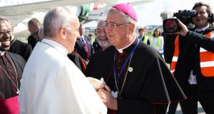 Archbishop Diarmuid Martin greets Pope Francis at his arrival at Dublin airport last August. Photograph: Maxwells
