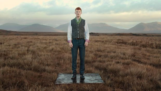 Sean Nós dancer Ryan Owens wearing a waistcoat by Bonner, gilet by De Bruir, Ireland's Eye Aran knit, Celtic tweed trousers and scarf by Aine. Film still: Perry Ogden/Showcase