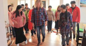 Musician Brendan Keegan delivering a a sean nós dance class to Chinese guests at Glen Keen Farm, Co Mayo. Thousands of Chinese visitors have been to the facility since 2014.