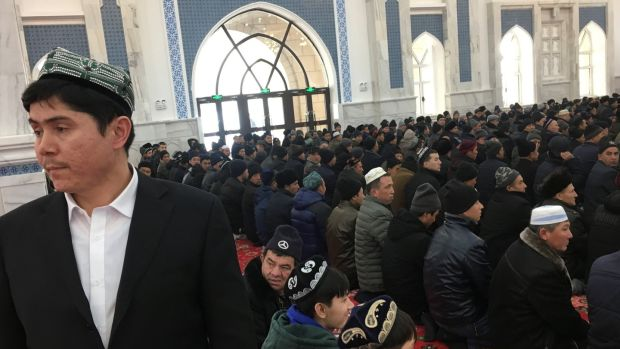 Men pray at the mosque at the Xinjiang Islamic Institute during a government organised trip in Urumqi, Xinjiang, China. Photograph: Ben Blanchard/Reuters
